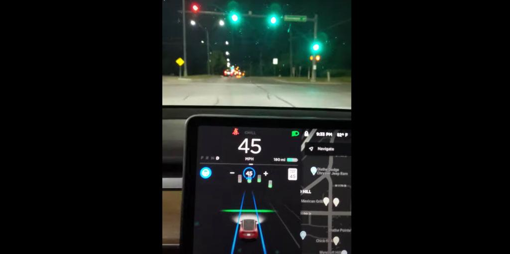 Watch Tesla Autopilot drive through green light 'knowingly' for the first time